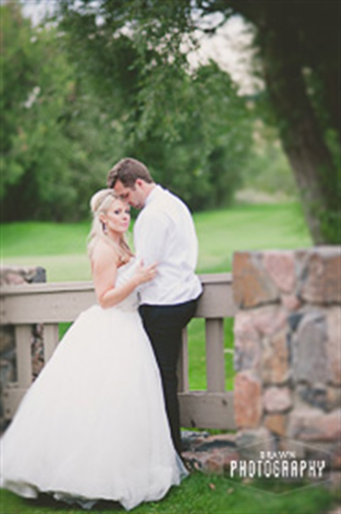 Wedding photo from Fox Hollow Golf Course on the bridge near the pavilion with photo courtesy of Brawn Photography